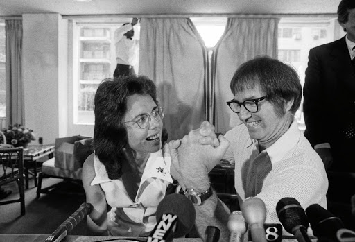 Former tennis great Bobby Riggs and top female tennis player Billie Jean King arm wrestle at a press conference, where they announced they'll face each other in a $100,000 winner-take-all tennis match. Billy Jean went on to defeat Riggs, 6-4, 6-3, 6-3.
